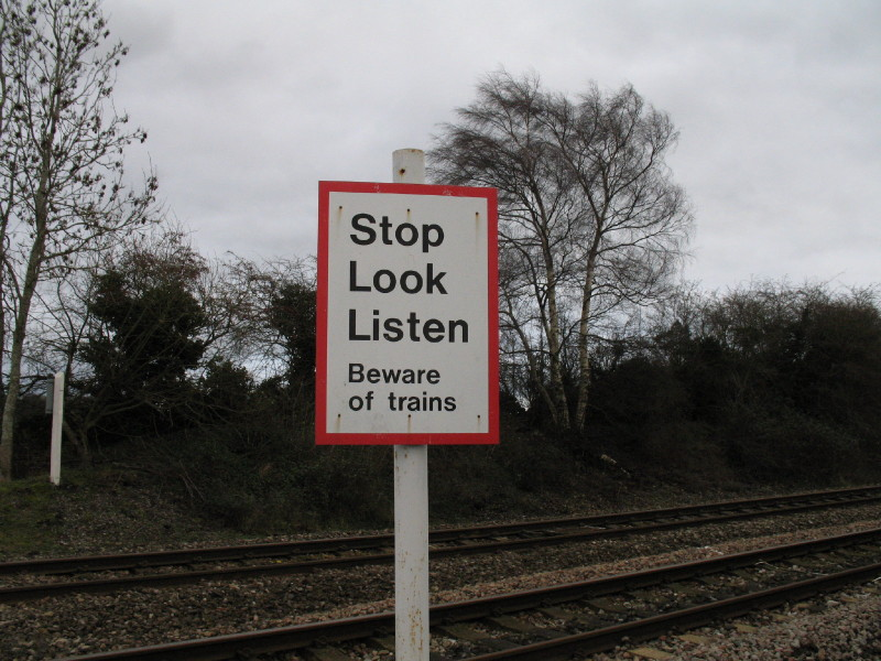 Stop Look Listen railway warning board