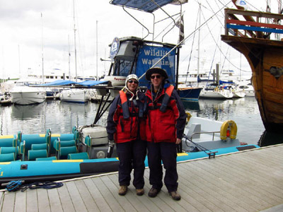 Lucy and Stephen by the Orca Sea Safaris boat in Falmouth harbour