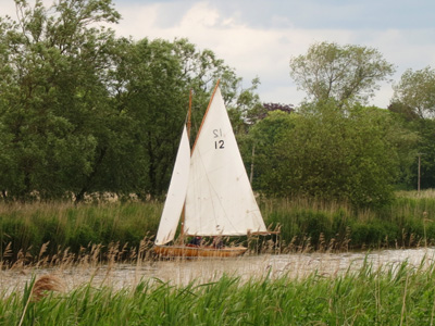 A boat sails up the Waveney during a walk on the Angles Way from Beccles to Oulton Broad in Lowestoft