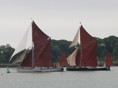 An overtaking manoeuvre on the River Orwell during the Thames Barge Match