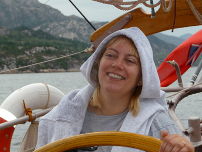 Lucy steering schooner Trinovante during a week's sailing in Norway